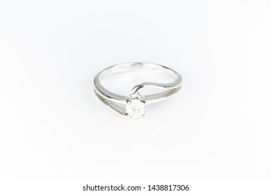 Close up of jewelry isolated on white background use for engagement ring. round shape diamond ring with large topaz and platinum, sapphire, Golden wedding rings for valentine's day or special occasion