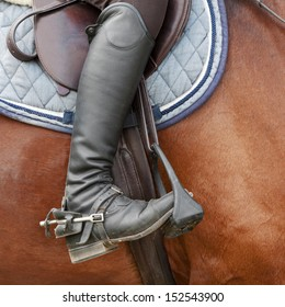 Close up of jockey riding boot, horses saddle and stirrup