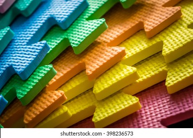 Close up of a joining parts of the colorful pieces of a children's soft toy mat