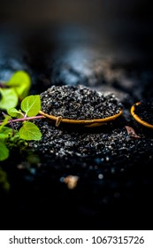 Close up of kalonji, Roman coriander, mint leaves, and powder of kalonji with its extracted oil for piles treatment, weight loss, healthy kidney, to low blood pressure etc.