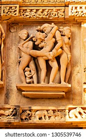 Close up of Kamasutra poses on the wall of Hindu temple in western group of temple Khajuraho, India - A Unesco World Heritage Site