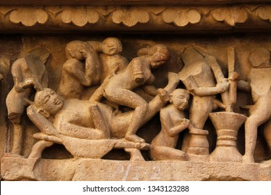 Close up of Kamasutra Pose/scenes on the wall of Hindu temple in Western Group of Temple Khajuraho, Madhya Pradesh