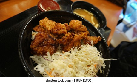 Close up of Karaagedon (Karaage on rice), Fried chicken, Cabbage alley and mayonnaise sauce, with miso soup, Japanese food.
