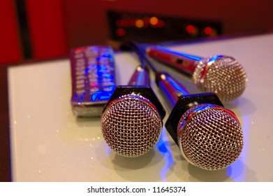 Close up of karaoke microphones and remote control