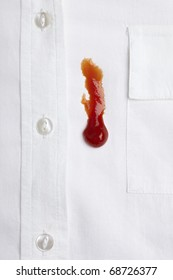 close up of ketchup stain on white shirt