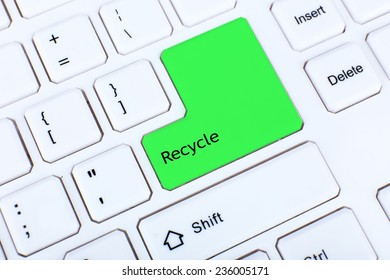 Close up of keyboard with Recycle sign