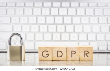 Close keypad lock with word GDPR on wooden cubes, white keyboard on background. European general data protection regulation, personal information, data privacy concepts.