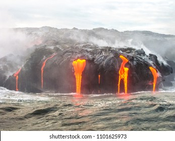 Close up of Kilauea Volcano, Hawaii Volcanoes National Park, also known Kilauea Smile because from 2016 seems to smile, erupting lava into Pacific Ocean, Big Island. Scenic sea view from the boat.