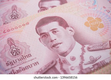 Close up King Maha Vajiralongkorn Bodindradebayavarangkun (Rama 10) on 100 baht Thai banknotes bill texture background. Concept of Thai baht payment currency of Thailand, Forex investment, stock trade