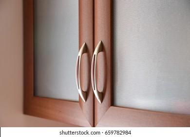 Close up of kitchen cabinet door handles