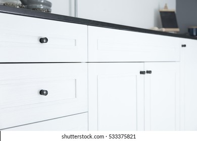Close up of kitchen cabinet door knobs
