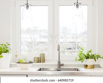 close up of a kitchen sink by the window