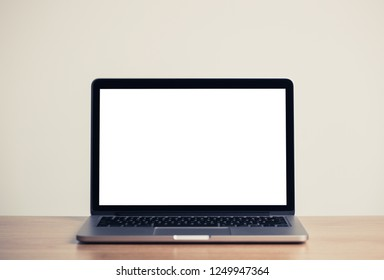 Close up Laptop Computer on Top of Office Table with Empty White Screen, Emphasizing Copy Space.