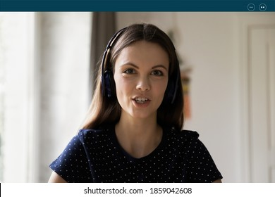 Close up laptop screen view confident young caucasian woman in wireless headphones giving educational online lecture, sharing professional knowledge or holding internet web camera video call.