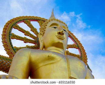 Close up of large buddha statue at Wat Phra Yai in Koh Samui, Thailand.