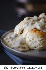 Close up of a large plate of biscuits and gravy