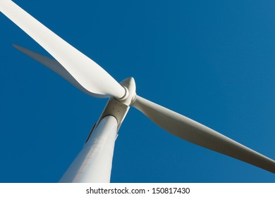 A close up of a large wind turbine in Portugal on a wind farm