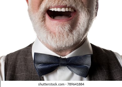 Close up of laughing oldish man with blue bow tied to his neck. Isolated on background