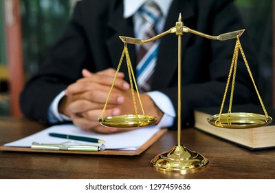 Close up lawyer businessman working or reading lawbook in office workplace for consultant lawyer concept.