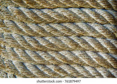 Close up layers of rope tied texture. image for background, wallpaper, objects and copy space. Macro parallel strands of the thick fiber rope texture concept.