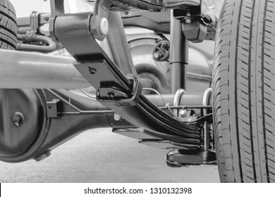 Close up Leaf spring suspension of pick up car truck black and white concept.