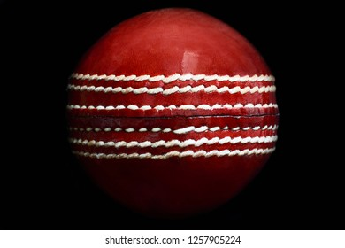 Close up of a leather cricket ball showing the seam
