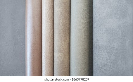 close up leather fabric catalog for interior uphostery works in light grey ,brown and beige tone color.