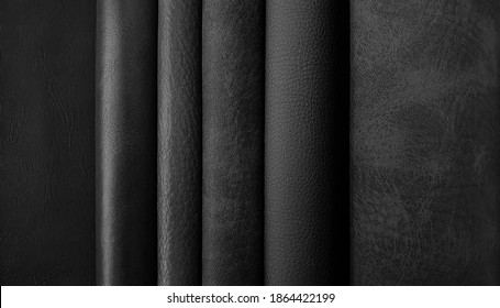 close up leather fabric catalog for interior uphostery works in dark black tone color.