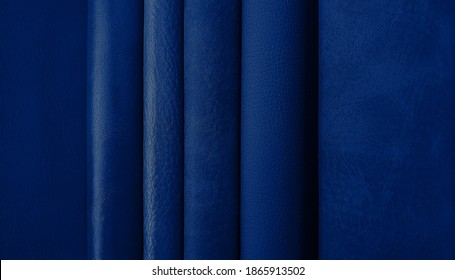 close up leather fabric samples catalog for interior uphostery works in various shade and tone of dark blue color.