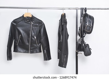 close up leather rivets jackets  with handbag on hanger