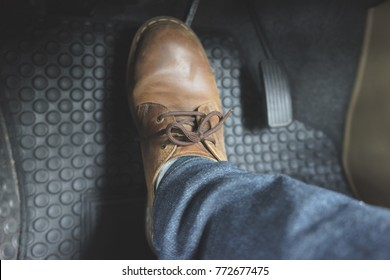 Close up Leather Shoe on pedal in car