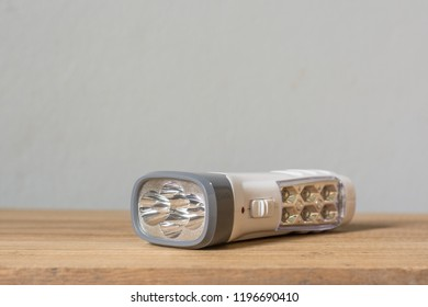 Close up LED flashlight on wood background, Multi function LED flashlight for home,Home accessories,
