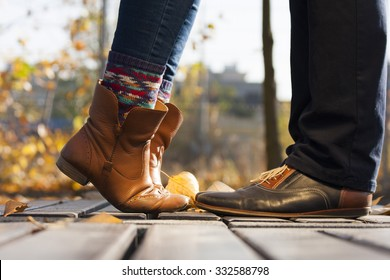 Close up of legs couple in love kissing outdoor in autumn