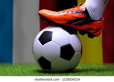 Close up legs and feet of soccer player or football player walk on green grass ready to play match on national France and national Belgium.
