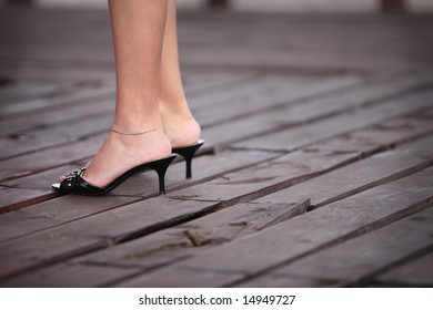 close up of legs in medium-high hill shoes