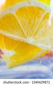 Close up lemon slice floating in water