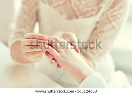 Lesbian wedding ring hand
