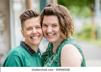 Close up of lesbian couple touching cheeks while standing outside