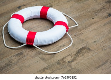 Close up lifebuoy,All Water rescue emergency equipment. white lifebuoy on wood floor. image for background, wallpaper, objects and copy space