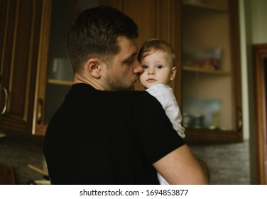 Close up lifestyle photo of father and his little daughter in the kitchen indoor