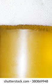 Close Up of Light Beer with Foam and Bubbles.