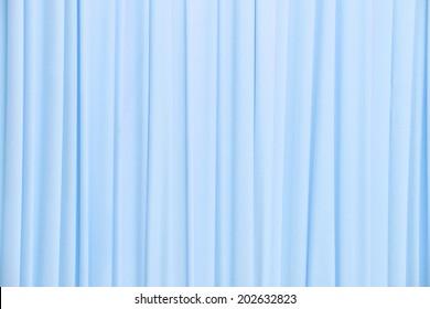Close up light blue color curtain texture background