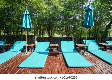 Close Up Light Blue Pool Chairs On Wooden Floor In Luxury Hotel
