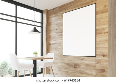 Close up of a light wooden cafe interior with a square table, white chairs standing along a panoramic window and a framed vertical poster on a wall. 3d rendering, mock up