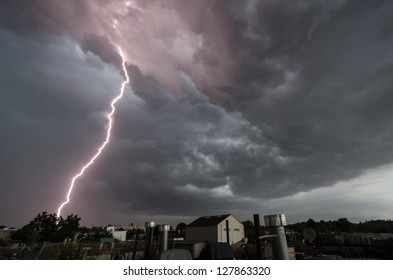 Close lightning strike over Brooklyn rooftops.