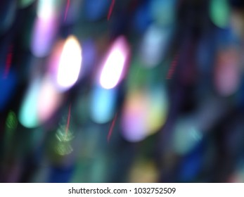 A close up of lights in pink, blue, greens yellow background. Sparkling.