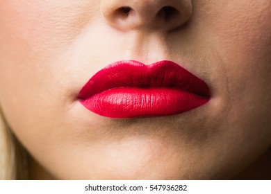 Close up of lips with makeup on them in a studio