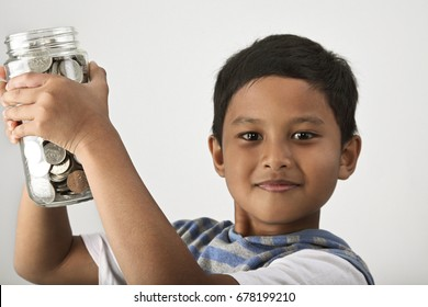 Close up of little boy holding coins