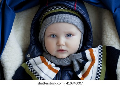 Close up Little boy in stroller in winter