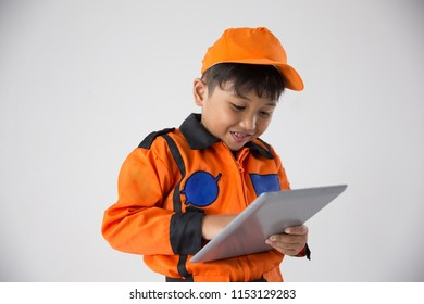 Close up little boy uniform as a astronout browsing with tablet on white background